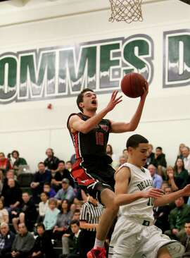 Senior guard Stefan Mitu (with ball) was Monte Vista's sixth man last year and is the Mustangs' leading scorer this season