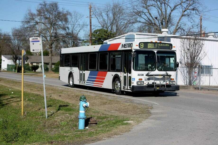 A Metro bus travels along Sweetwater Lane and Peach Spring Drive in Houston in north Houston. ( Gary Coronado / Houston Chronicle ) Photo: Gary Coronado, Staff / © 2015 Houston Chronicle