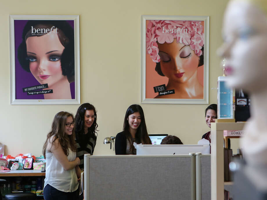 Workers gather around a computer at Benefit Cosmetics, where mannequins and whimsical touches abound. Photo: Amy Osborne / The Chronicle / ONLINE_YES