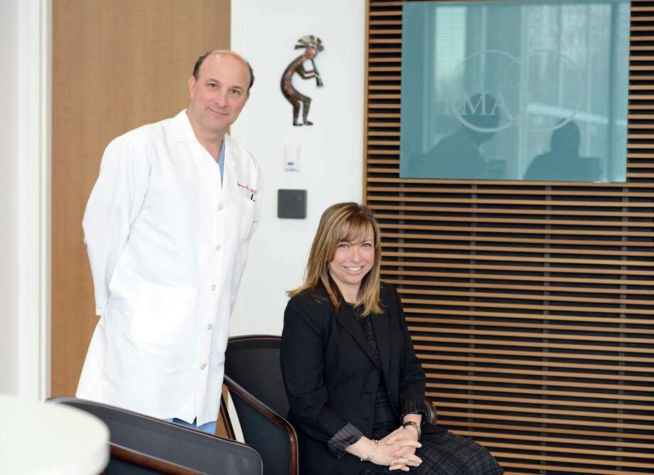 CEO Robin Mangieri and Dr. Spencer Richlin, Surgical Director and an infertility specialist in reproductive endocrinology, pose for a photo in the new offices of Reproductive Medicine Associates of Connecticut (RMACT) Tuesday, Feb. 10, 2015.  The new Norwalk location in iPark office complex boasts one of the most advanced IVF labs in the country. Photo: Autumn Driscoll / Connecticut Post