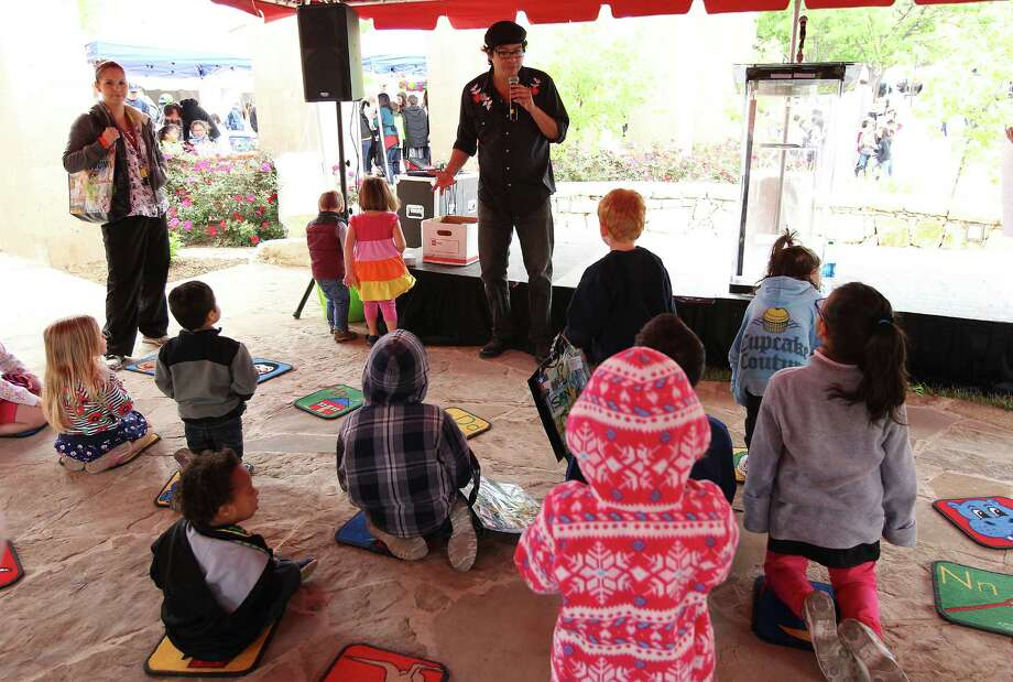 As it did last year, the San Antonio Book Festival will feature activities for children.\Say Sî Theater Arts Director Joel Settles (center) volunteers to read to children at the second annual San Antonio Book Festival at the Central Library on Saturday, Apr. 5, 2014. (Kin Man Hui/San Antonio Express-News) Photo: Kin Man Hui /San Antonio Express-News File Photo / ©2014 San Antonio Express-News