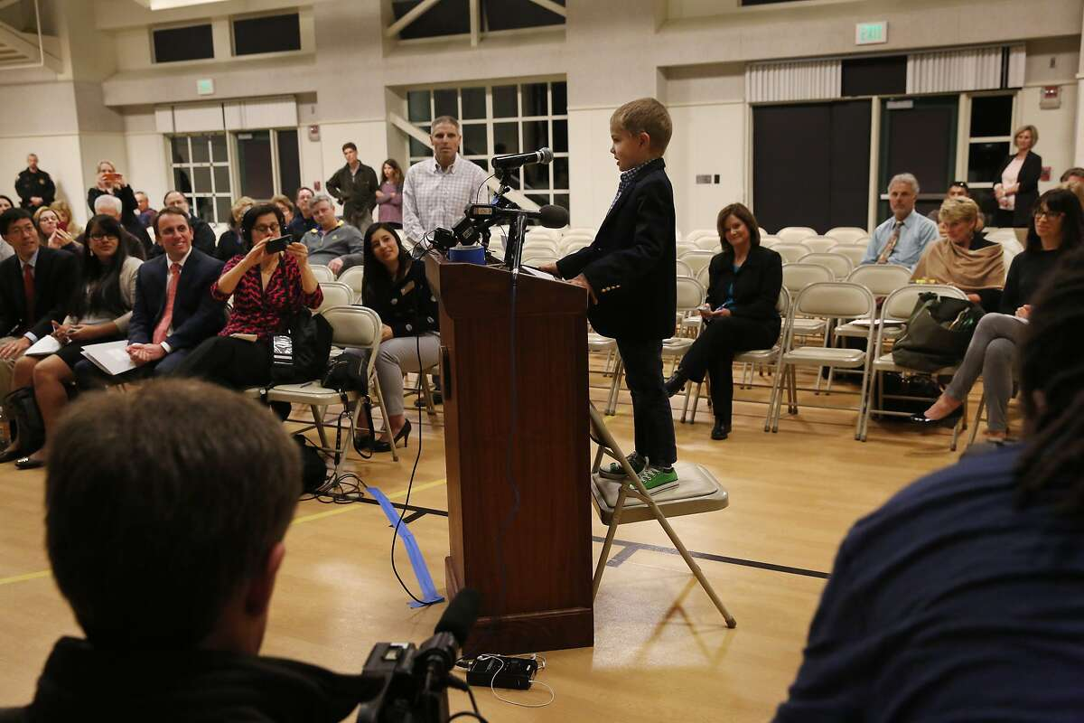 Rhett Krawitt, 7, a leukemia survivor, recites a practiced speech about being in support of the measles vaccine to the board, public and media members during a regular meeting of the Reed Union School Board of Trustees held at Bel Aire Elementary School campus Feb. 10, 2015 in Tiburon, Calif. Among other things, the board discussed the measles vaccine and the option of parents to opt out of giving it to their children. Community members, including 7-year-old Rhett Krawitt and his parents spoke out against the opt-out option in order to keep schools safe for children with low immunity or who are too young to get vaccinated.