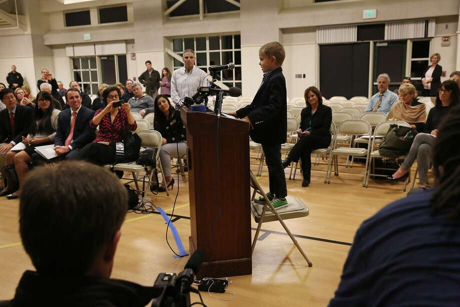 Rhett Krawitt, 7, a leukemia survivor, recites a practiced speech about being in support of the measles vaccine to the board, public and media members during a regular meeting of the Reed Union School Board of Trustees held at Bel Aire Elementary School campus Feb. 10, 2015 in Tiburon, Calif. Among other things, the board discussed the measles vaccine and the option of parents to opt out of giving it to their children. Community members, including 7-year-old Rhett Krawitt and his parents spoke out against the opt-out option in order to keep schools safe for children with low immunity or who are too young to get vaccinated. Photo: Leah Millis, The Chronicle