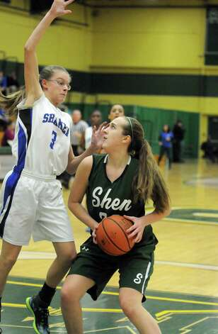 Shenendehowa's Carly Boland drives to the basket during their girl's high school basketball game against Shaker at Siena College on Tuesday Feb. 10, 2015 in Loudonville ,N.Y.  (Michael P. Farrell/Times Union) Photo: Michael P. Farrell / 00030535A