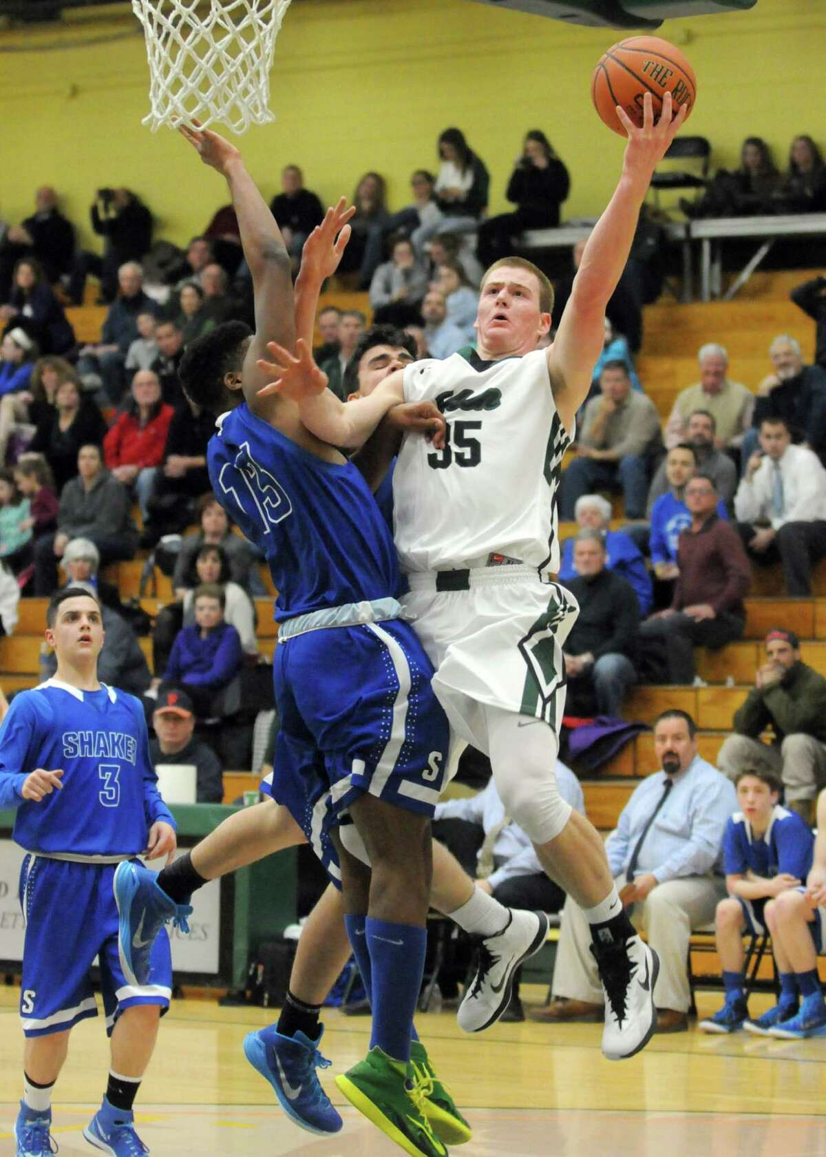 Shenendehowa's Brandon Fischer goes in for a basket during their boy's high school basketball game against Shaker at Siena College on Tuesday Feb. 10, 2015 in Loudonville ,N.Y. (Michael P. Farrell/Times Union)
