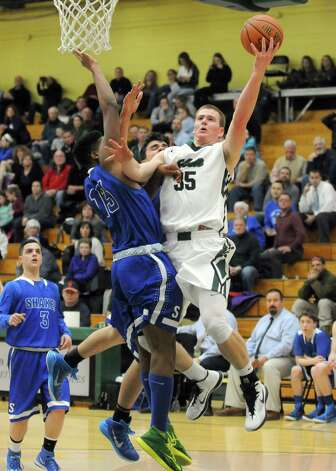 Shenendehowa's Brandon Fischer goes in for a basket during their boy's high school basketball game against Shaker at Siena College on Tuesday Feb. 10, 2015 in Loudonville ,N.Y.  (Michael P. Farrell/Times Union) Photo: Michael P. Farrell / 00030536A