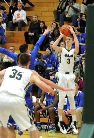 Shenendehowa's Kevin Huerter puts up a three point shot for a score during their boy's high school basketball game against Shaker at Siena College on Tuesday Feb. 10, 2015 in Loudonville ,N.Y.  (Michael P. Farrell/Times Union) Photo: Michael P. Farrell / 00030536A