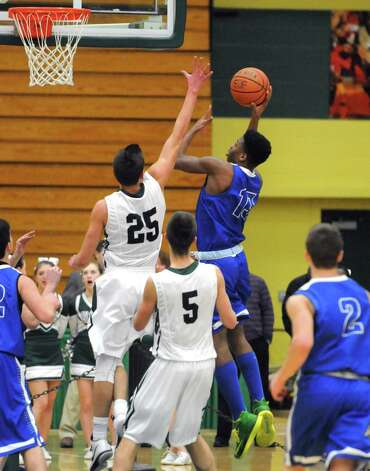 Shakers's Omari Lewis goes in for a score during their boy's high school basketball game against Shenendehowa at Siena College on Tuesday Feb. 10, 2015 in Loudonville ,N.Y.  (Michael P. Farrell/Times Union) Photo: Michael P. Farrell / 00030536A