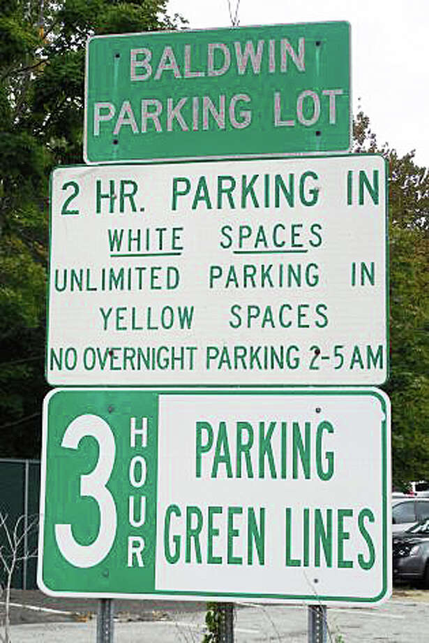 Signs posting parking rules and regulations, such as this one at the Baldwin parking lot, can be confusing for drivers searching for a downtown parking spot. Photo: File Photo / Westport News