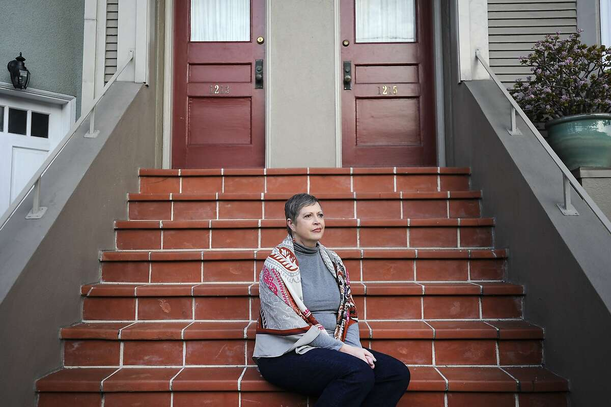 Christie White, the lead patient in a lawsuit filed against California to allow terminally ill patients to die at their own choosing with the assistance of their physicians who was also diagnosed with leukemia seven years ago, but is now in remission, poses for a portrait at her home in San Francisco, CA, on Tuesday, February 10, 2015.