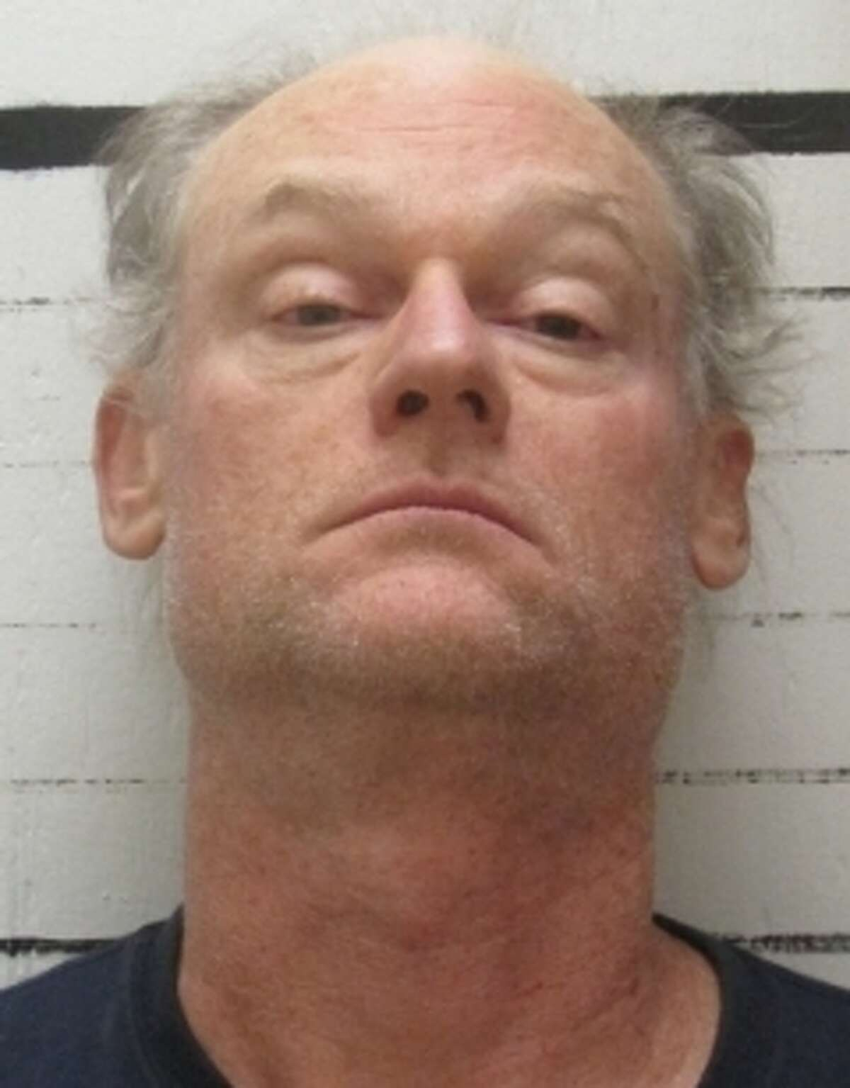 Deputies arrested an Oklahoma farmer after arriving on the scene of his Muskogee ranch and found graphic scene of more than three dozen dead horses and cows.