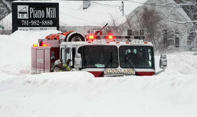 A Rockland, Mass., firetruck sits outside the Piano Mill music store after its roof partially collapsed into the showroom from the weight of 29 inches of new snow Tuesday, Feb. 10, 2015, in Rockland, Mass. The store is home to a rhinestone-covered grand piano once owned by Liberace. Store owner Rob Norris said it is unclear if the Liberace piano was damaged. No one was in the building at the time of the collapse, nor was anyone being allowed inside until a structural engineer assesses damage. (AP Photo/The Brockton Enterprise, Marc Vasconcellos)  ORG XMIT: MABRO103 Photo: Marc Vasconcellos, AP / The Enterprise