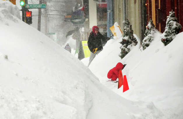 Snow is piled high along the business area of State Street, Monday, Feb. 9, 2015, in Newburyport, Mass. A long duration winter storm that began Saturday night remains in effect for a large swath of southern New England until the early morning hours Tuesday.  (AP Photo/Newburyport Daily News, Bryan Eaton) ORG XMIT: MANEP101 Photo: Bryan Eaton, AP / Newburyport Daily News