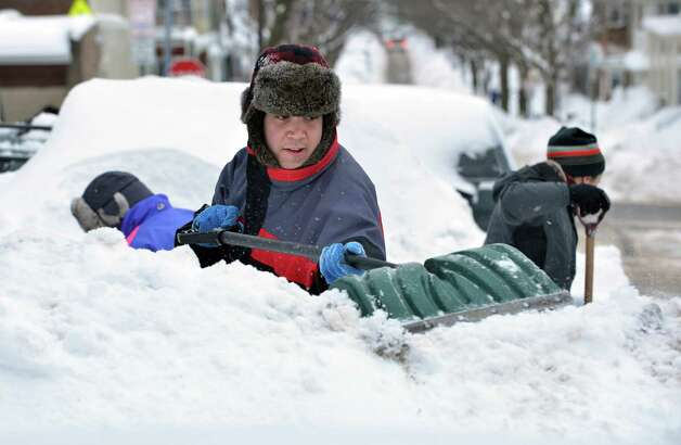 Will Chapman, of Oakland, Calif., shovels out a parking space after digging out his car from between snow piles near the house he was visiting in Somerville, Mass., Tuesday, Feb. 10, 2015. The latest snowstorm left the Boston area with another two feet of snow and forced the MBTA to suspend all rail service for the day. (AP Photo/Josh Reynolds) ORG XMIT: MACR102 Photo: Josh Reynolds, AP / FR25426 AP