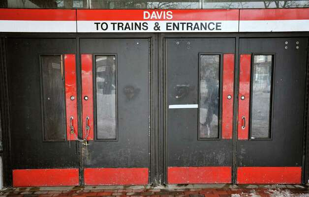 Locked doors confront would-be passengers at the entrance to the MBTA subway station at Davis Square in Somerville, Mass., Tuesday, Feb. 10, 2015. The third major winter storm in two weeks left the Boston area with another two feet of snow and forced the MBTA to suspend all rail service for the day. (AP Photo/Josh Reynolds) ORG XMIT: MACR111 Photo: Josh Reynolds, AP / FR25426 AP