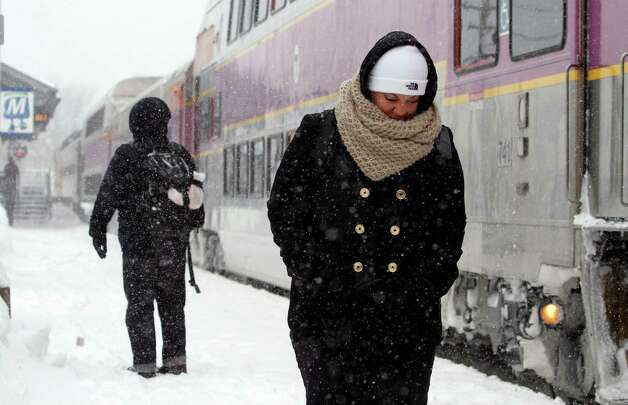 Passengers wait at the commuter rail train station Monday, Feb. 9, 2015, in Framingham, Mass. New England and portions of New York state awoke Monday to a fresh blanket of snow as a storm threatening to bring up to 1 to 2 feet to some areas churned across the Northeast, making for a slippery, tedious commute to start the workweek. (AP Photo/Bill Sikes) ORG XMIT: MAWS111 Photo: Bill Sikes, AP / AP