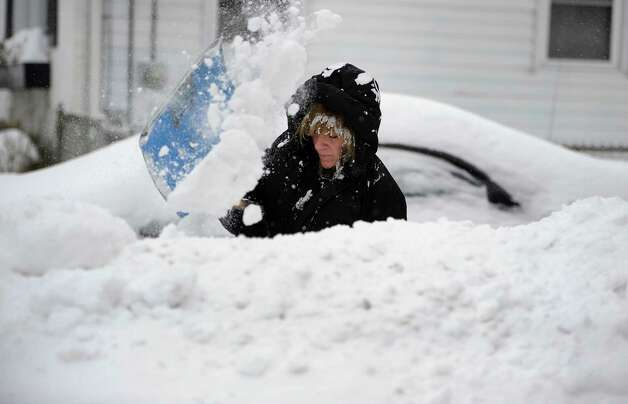 Laurel Casasanta shovels out her driveway, Monday, Feb. 9, 2015, in Manchester, Conn.  New England and portions of New York state awoke Monday to a fresh blanket of snow as a storm threatening to bring up to 1 to 2 feet to some areas churned across the Northeast, making for a slippery, tedious commute to start the workweek. (AP Photo/Jessica Hill) ORG XMIT: CTJH102 Photo: Jessica Hill, AP / FR125654 AP