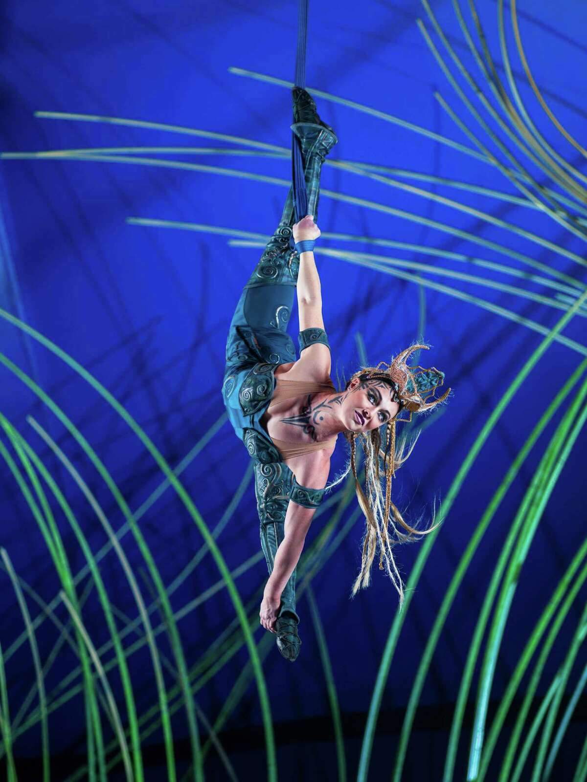 Kylee Maupoux executes an aerial spin during the performance.