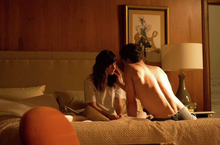 "Dakota Johnson and Jamie Dornan star in ""Fifty Shades of Grey.""  Photo: Chuck Zlotnick / © Universal Pictures"
