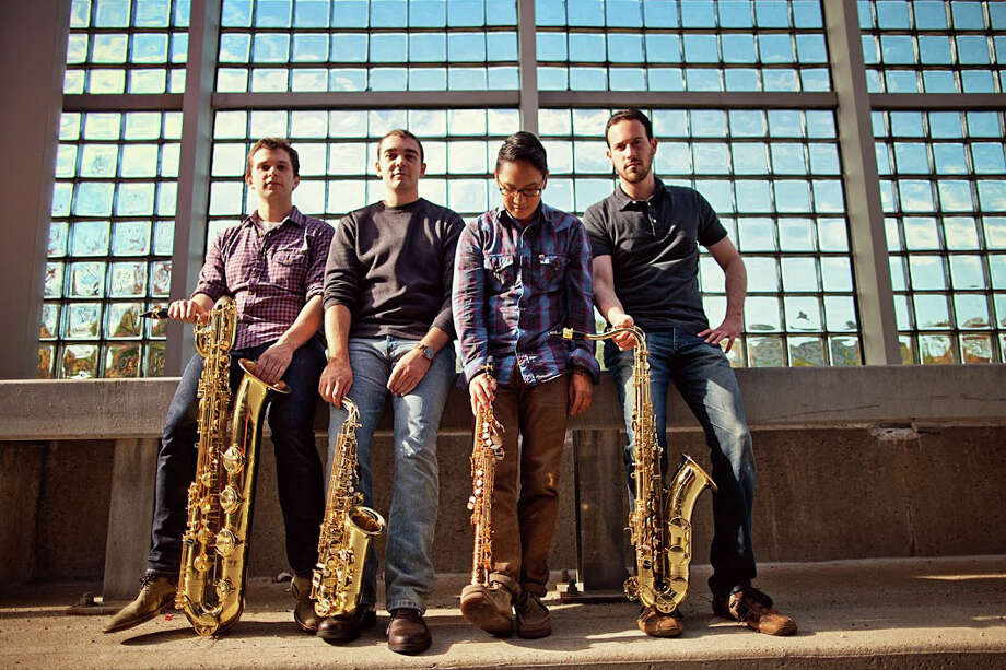 Asylum Quartet, a quartet of four classically-trained saxophonists who met as graduate students at the The Hartt School in West Hartford, Conn., have been earning awards and attention since forming several years ago. The group, which includes, from left, Andrew Barnhart (baritone saxophone), Tony Speranza (alto saxophone), Joseph Abad (soprano saxophone) and Max Schwimmer (tenor saxophone), will perform at the First Congregational Church of Greenwich, in Old Greenwich, Conn., on Sunday, Feb. 22, 2015. Photo: Contributed Photo / Stamford Advocate Contributed photo