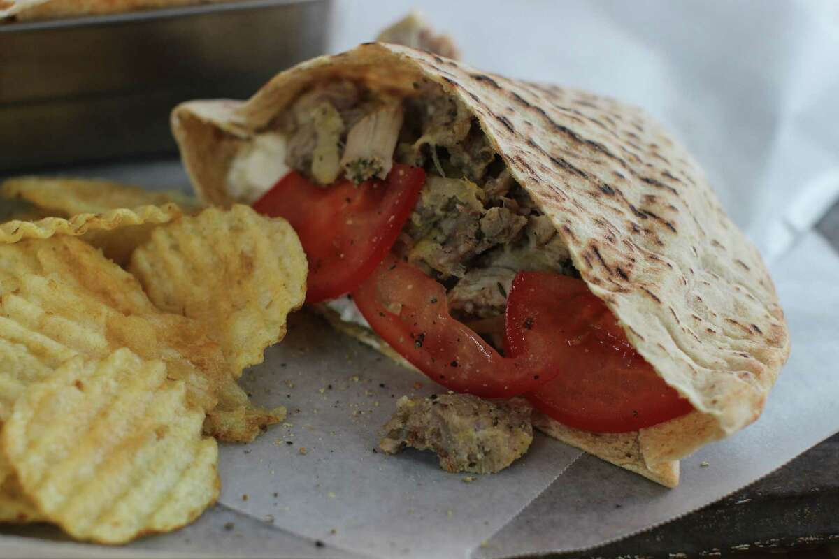 This Jan. 19, 2015 photo shows slow cooker pulled chicken Greek pitas in Concord, N.H. (AP Photo/Matthew Mead) ORG XMIT: MER2015021010100077