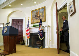 President Obama arrives in the Roosevelt Room of the White House to speak about his plan to defeat the Islamic State.