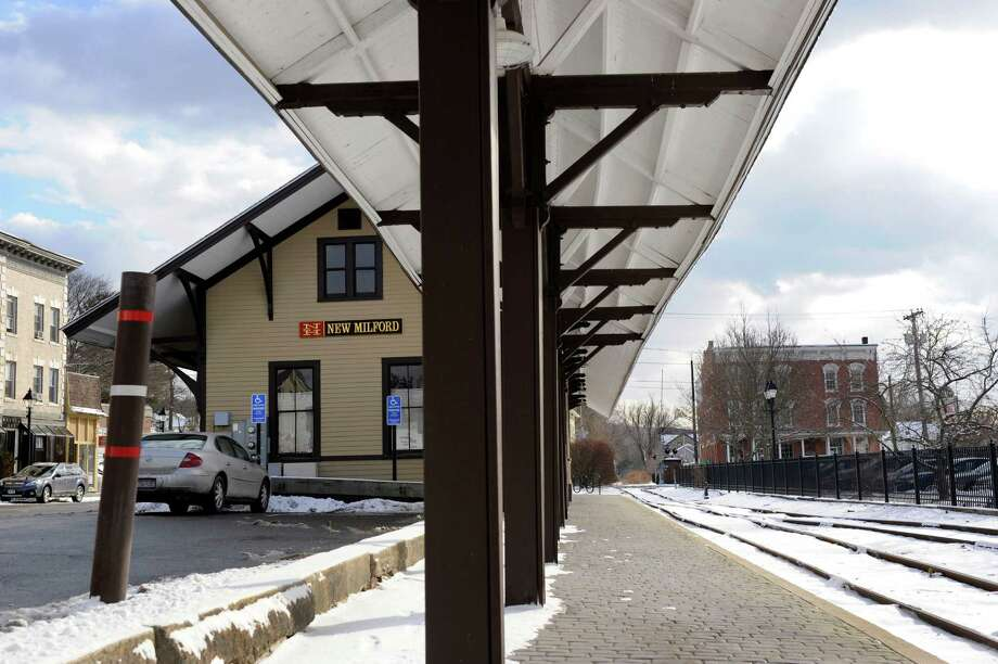 New Milford's old train station on Railroad Street, left, now houses the New Milford Chamber of Commerce. Photo: Carol Kaliff / The News-Times