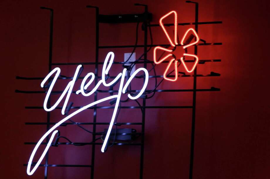 This 2011 file photo shows the logo of the online reviews website Yelp on a wall at the company's offices in New York. Photo: Kathy Willens / Associated Press / AP