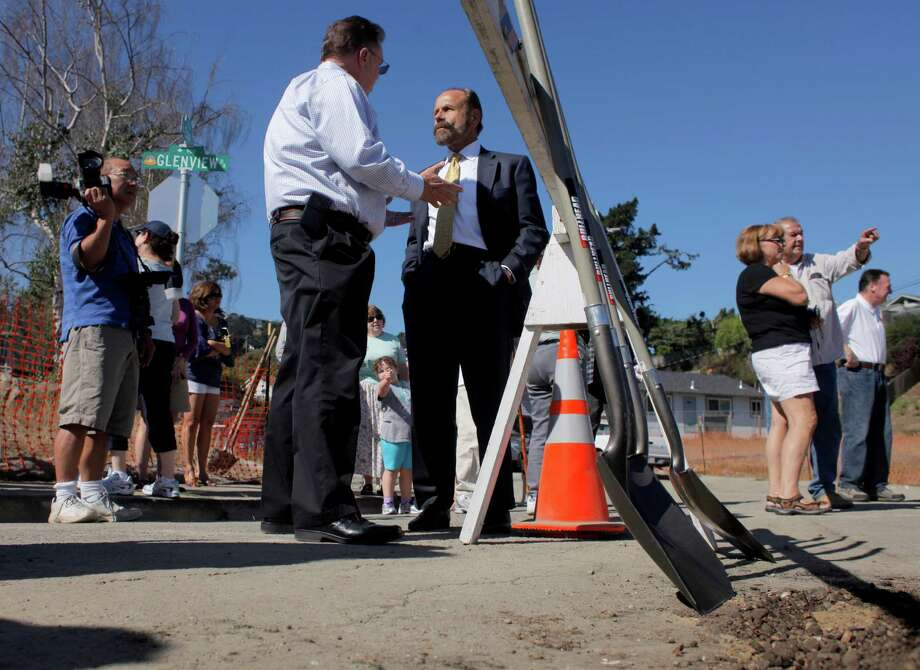 San Bruno Mayor Jim Ruane, left and Assemblyman Jerry Hill talk about the proceeding of the ceremonial shoveling of dirt in the crater, Tuesday September 20, 2011, in San Bruno, Calif. The residents of the San Bruno Crestmoor neighborhood were allowed to express themselves as they helped fill the crater which was created by the PG&E pipeline explosion, by shoveling dirt into the hole. Photo: Lacy Atkins / The Chronicle / SFC