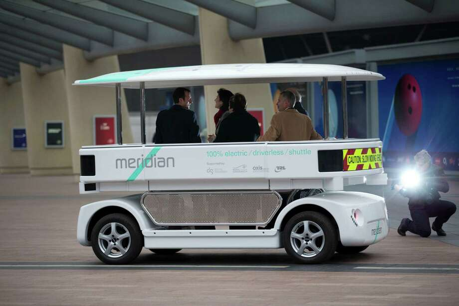 Dignitaries try out a prototype driverless car called a Meridian shuttle Wednesday during a launch event near the O2 Arena in London.  Photo: Matt Dunham, STF / AP