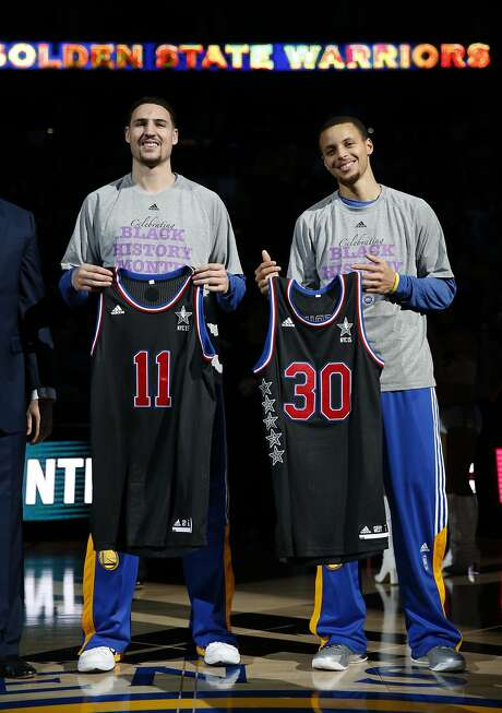Klay Thompson and Stephen Curry were presented with their All-Star jerseys in a ceremony just prior to Curry's 51-point game. Photo: Scott Strazzante, The Chronicle