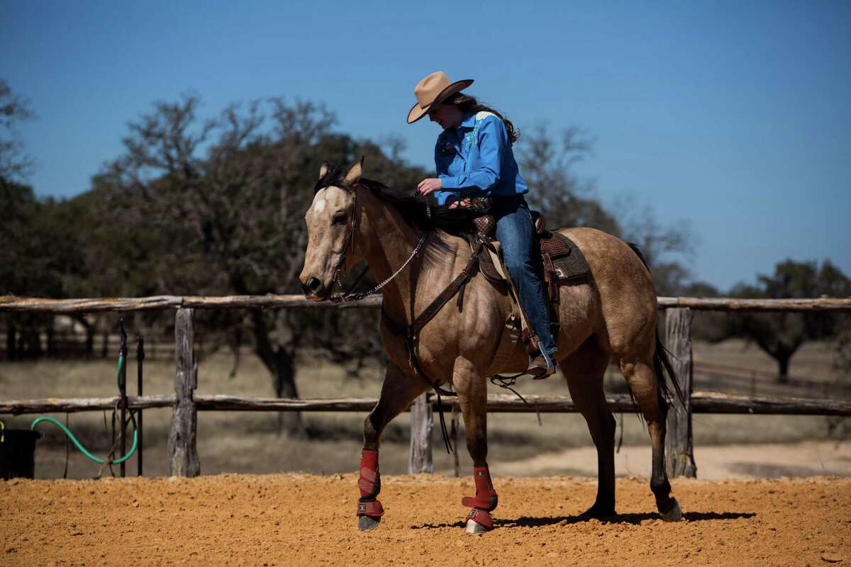 """Callie duPerier rides her horse Dillon on her family's ranch in Boerne, TX on Tuesday, February 10, 2015. She said, """"When I am riding Dillon and can feel his heart beating and my heart beating, its an adrenaline rush."""""""
