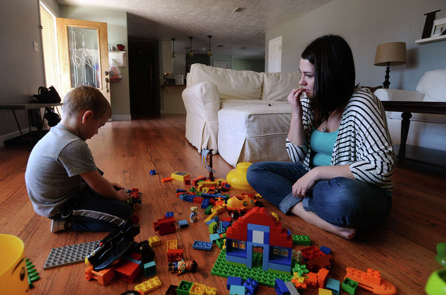 Jennifer Lewis, right, watches her son Evan, 4, play with Legos on Tuesday afternoon. Lewis made the decision to not vaccinate her son and said she is opposed to the idea of mandated vaccinations. Photo taken Tuesday 2/10/15 Jake Daniels/The Enterprise Photo: Jake Daniels / ©2014 The Beaumont Enterprise/Jake Daniels