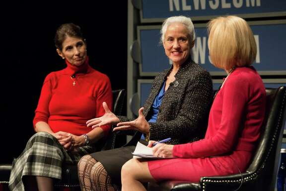 Diane Foley, left, and Debra Tice take part in a program on threats to journalism moderated by Judy Woodruff, right, in Washington. Foley's and Tice's sons are both victims of Islamic militants. (AP Photo/Molly Riley)