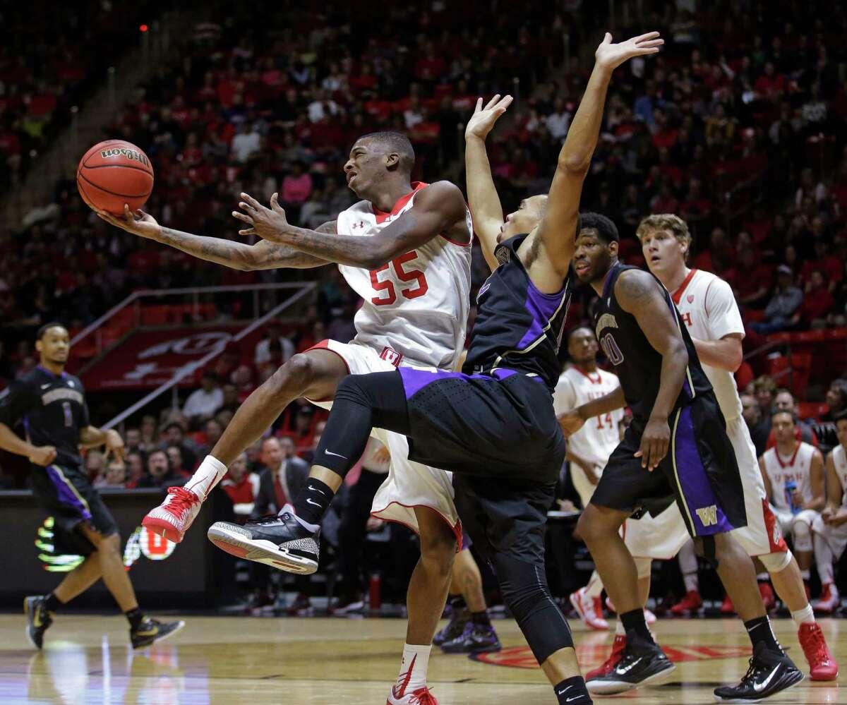 Utah guard Delon Wright flips the ball up as Washington guard Andrew Andrews.