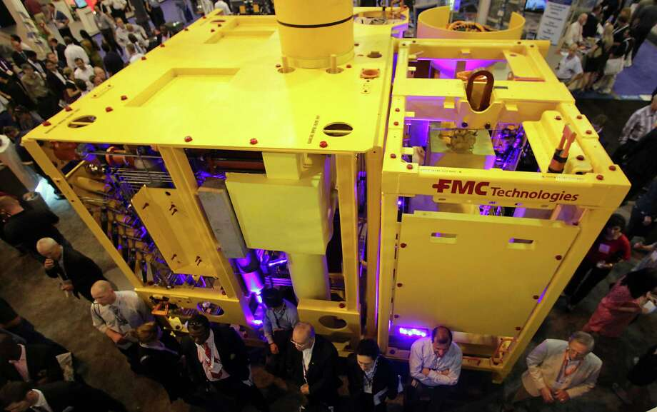 FMC Technologies, which manufactures subsea equipment including this deep-water tree on display at the 2013 Offshore Technology Conference, says it's laying off 2,000 workers. Photo: James Nielsen, Staff / © 2013  Houston Chronicle