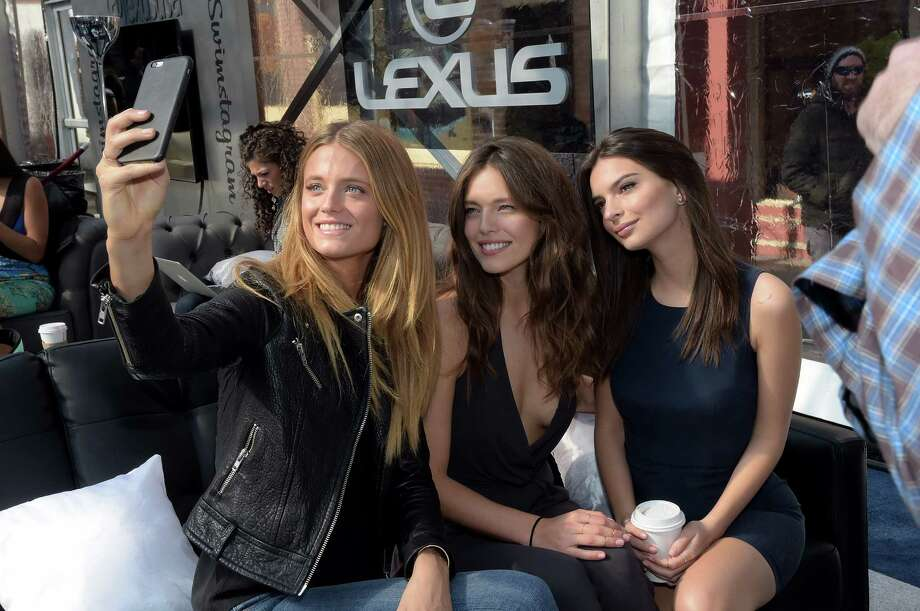 """(L-R) Models Kate Bock, Emily DiDonato, and Emily Ratajkowski attend 2015 Sports Illustrated Swimsuit's """"Swimville"""" Takes Over Nashville! on February 11, 2015 in Nashville, Tennessee. Photo: Rick Diamond, (Credit Too Long, See Caption) / 2015 Getty Images"""