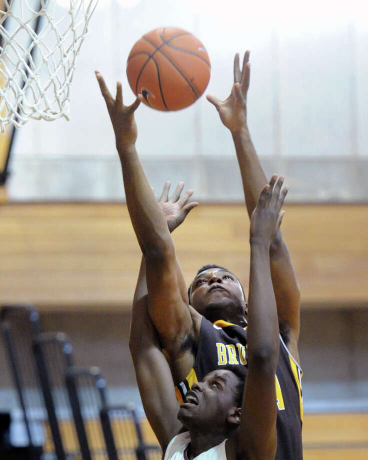 At top, Opong Bramble of Brunswick grabs an offensive rebound as he goes high above Hopkins defender Edens Fleuizaro during the boys high school basketball game between Brunswick School and Hopkins School at Brunswick in Greenwich, Conn., Wednesday, Feb. 11, 2015. Brunswick won the game, 75-72. Photo: Bob Luckey / Greenwich Time