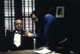 """In """"The Godfather,"""" Francis Ford Coppola (right) with Marlon Brando, addresses the Italian immigrant experience."""