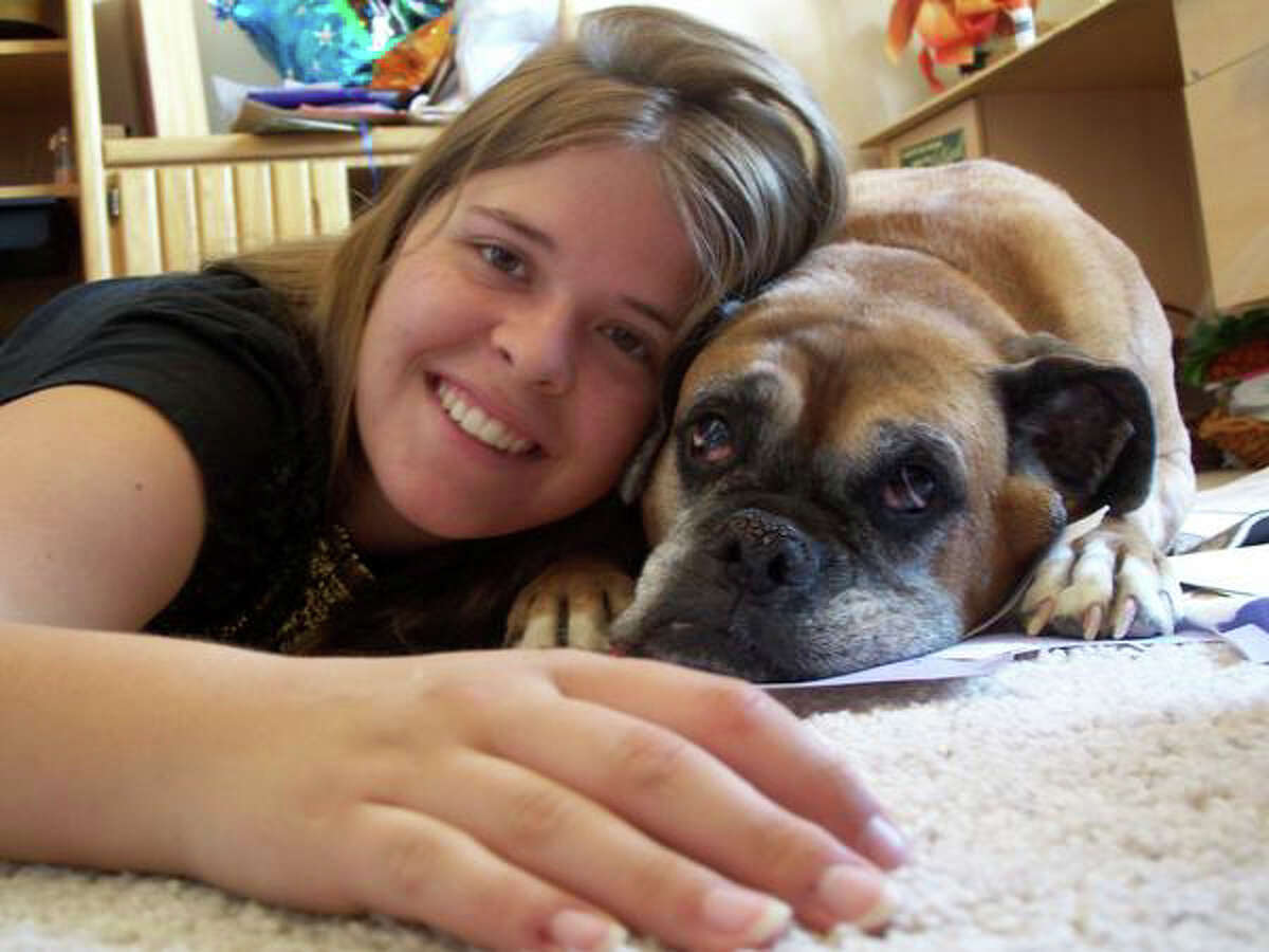 Kayla Mueller, the American aid worker abducted by the Islamic State group, with her dog. Her parents said Tuesday that they now had proof from the militant group that she was dead, four days after it claimed she had been killed in a Jordanian air strike.