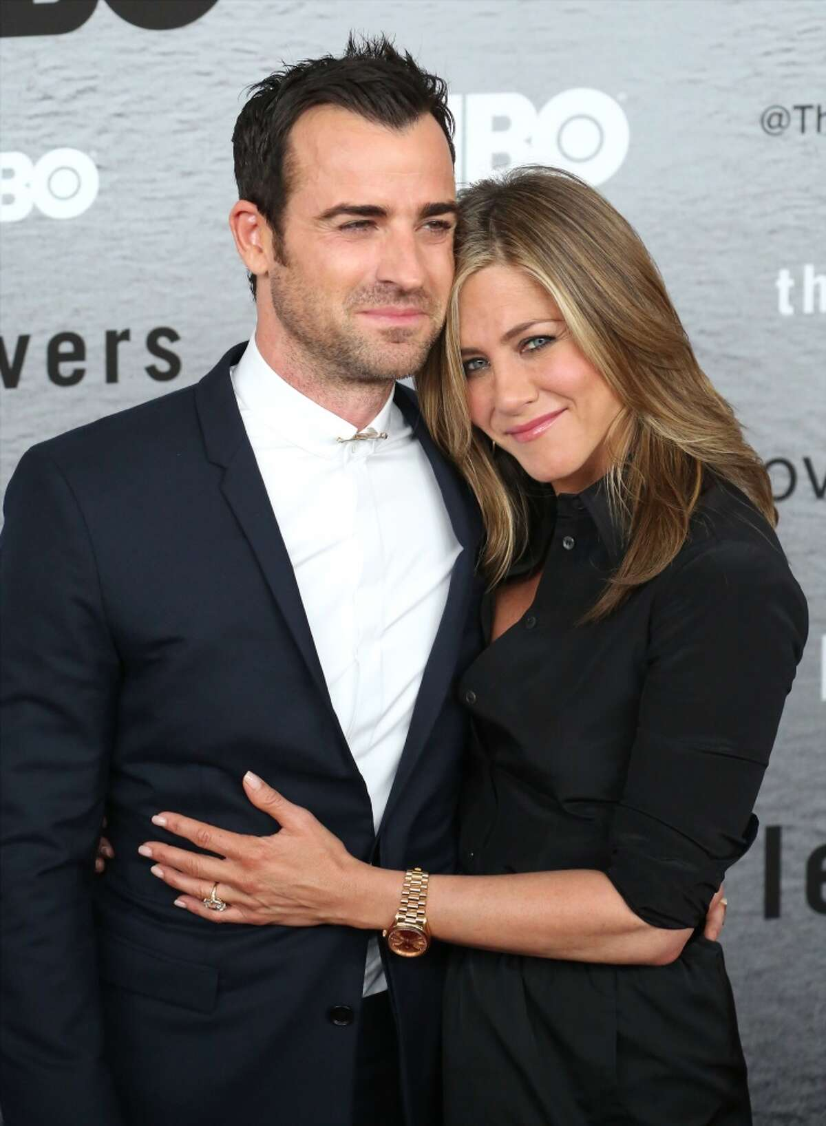 """Justin Theroux and Jennifer Aniston attend """"The Leftovers"""" premiere at NYU Skirball Center on June 23, 2014 in New York City."""