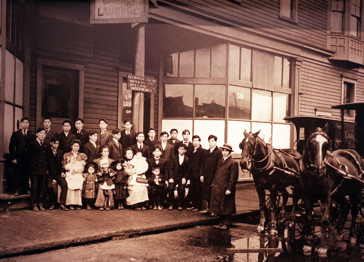 Eagle Laundry in Seattle's International District, circa 1906, operated by the Okamura family. Pictured in a Wing Luke Asian Museum photo publised in the Seattle Post-Intelligencer.