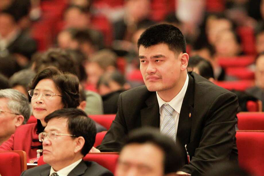 China's former NBA superstar Yao Ming, an elected member of the Chinese People's Political Consultative Conference (CPPCC) of Shanghai, takes part in a meeting of Shanghai People's Congress in Shanghai. Not content with owning a basketball team, studying business and making wine, China's former NBA superstar Yao Ming has now become the youngest -- and tallest -- legislative adviser in Shanghai. Photo: STR, AFP/Getty Images / AFP