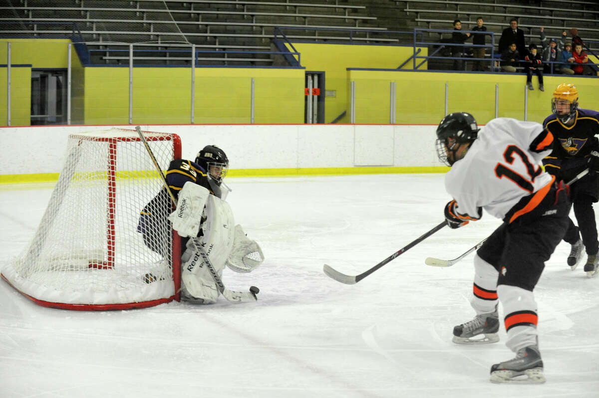 Westhill goalie Christian Compolattaro makes a save from a shot from Stamford's Chris Clemenson during their game at Terry Conners Rink in Stamford, Conn., on Wednesday, Feb. 11, 2015. Westhill came away with the City Championship with a 5-0 win over Stamford.