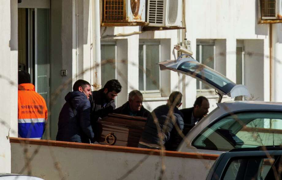 As the body of one of the 29 migrants who died  during the voyage that began over the weekend in Libya,  is  transported to Sicily, as officials debate what to do. Photo: Mauro Buccarello, STR / AP