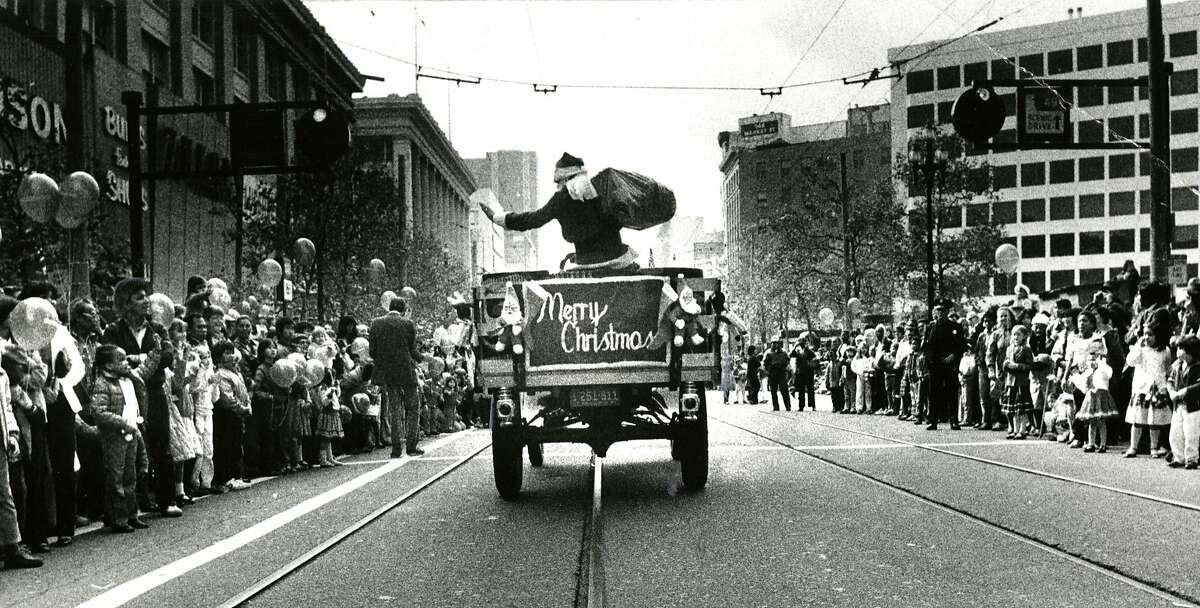 The Emporium Santa rolls down Market Street on Nov. 21, 1982.