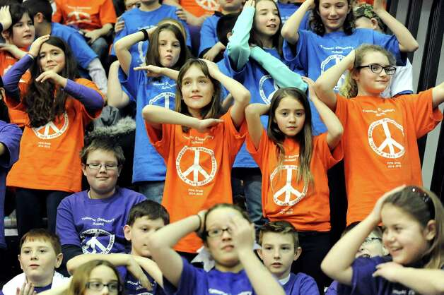 Tamarac Elementary students do the Macarena dance during halftime when the UAlbany women take on Binghamton in their basketball game on Wednesday, Feb. 11, 2015, at SEFCU Arena in Albany, N.Y. (Cindy Schultz / Times Union) Photo: Cindy Schultz / 00030541A