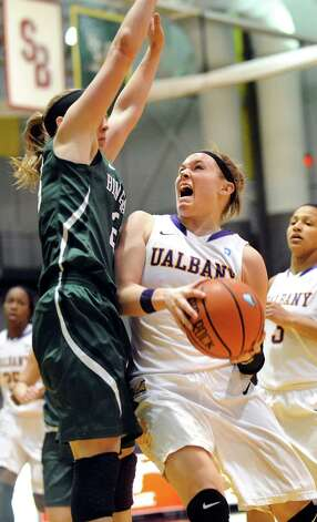 UAlbany's Sarah Royals, right, runs into the defense of Binghamton's Kim Albrecht during their basketball game on Wednesday, Feb. 11, 2015, at SEFCU Arena in Albany, N.Y. (Cindy Schultz / Times Union) Photo: Cindy Schultz / 00030541A