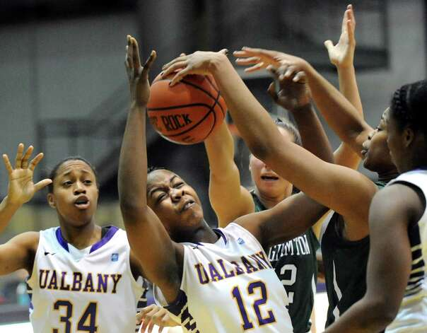 UAlbany's Imani Tate, center, battles for a loose ball during their basketball game against Binghamton on Wednesday, Feb. 11, 2015, at SEFCU Arena in Albany, N.Y. (Cindy Schultz / Times Union) Photo: Cindy Schultz / 00030541A