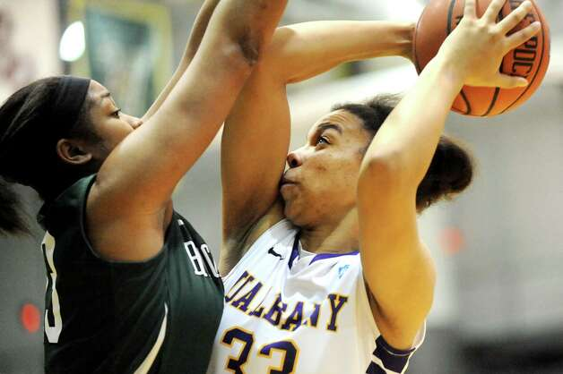 UAlbany's Tiana-Jo Carter, right, aims for the hoop as Binghamton's Sherae Swinson defends during their basketball game on Wednesday, Feb. 11, 2015, at SEFCU Arena in Albany, N.Y. (Cindy Schultz / Times Union) Photo: Cindy Schultz / 00030541A